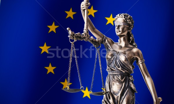 Themis with scale, symbol of justice on European Union flag back Stock photo © simpson33
