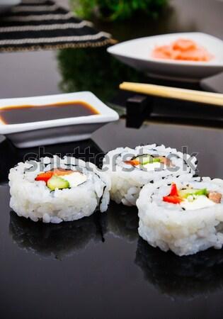 Sushi set on black bamboo mat Stock photo © simpson33