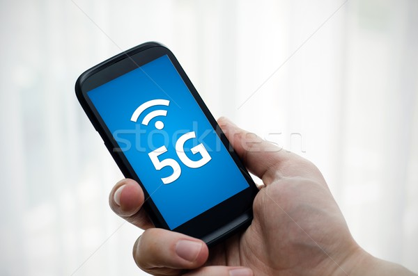 Smart phone with 5G network standard communication Stock photo © simpson33