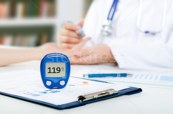 Doctor checking blood sugar level Stock photo © simpson33