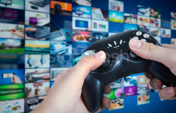 Gamer holding game pad in hands. Game play controller with strea Stock photo © simpson33