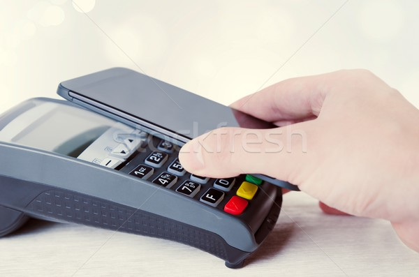 Mobile payment with smart phone Stock photo © simpson33