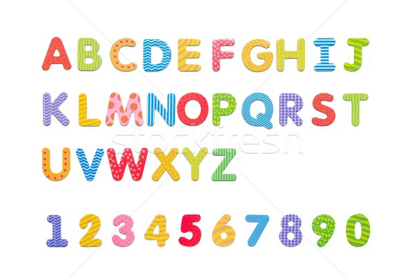 Colorful paper alphabet magnets on a whiteboard. Letters set iso Stock photo © simpson33