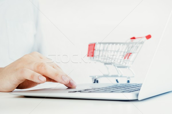 Man using laptop for internet shopping. Composition with shoppin Stock photo © simpson33