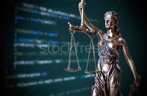 Justice statue with code on screen in background Stock photo © simpson33