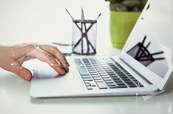 Man working with modern laptop in office Stock photo © simpson33