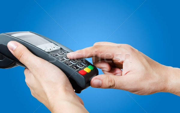 Hand with credit card swipe through terminal for sale Stock photo © simpson33