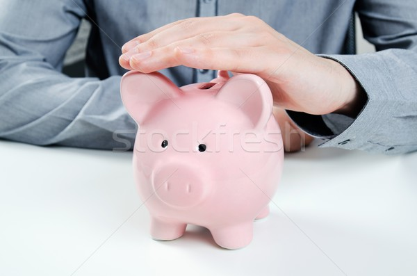 Business man with piggy bank. Saving money concept Stock photo © simpson33