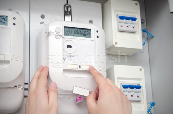 Electric energy meter. Electrical technician servicing unit Stock photo © simpson33