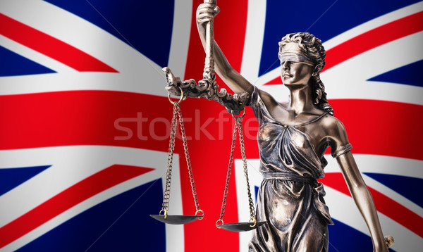Themis with scale, symbol of justice on UK flag background Stock photo © simpson33