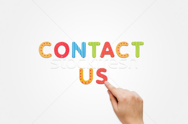 Hand put the words Contact Us with magnetic letters Stock photo © simpson33
