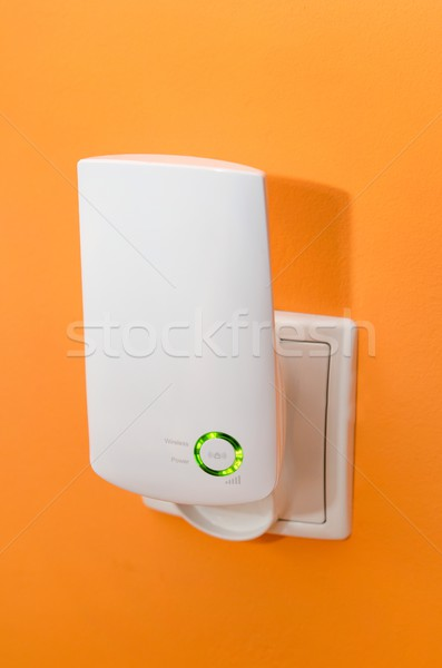 WiFi repeater in electrical socket. Simply way to extend wireles Stock photo © simpson33