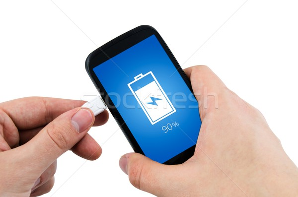 Man using phone charger via USB Stock photo © simpson33