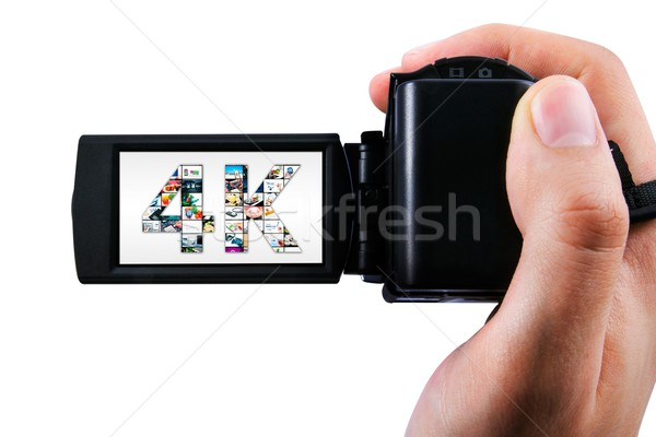 Hand holding Ultra High Definition camcorder isolated on white Stock photo © simpson33