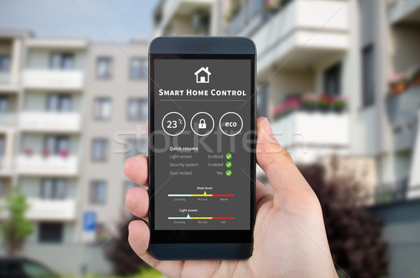 Smart home control technology. Remote automation system on mobil Stock photo © simpson33