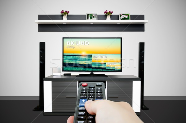 Watching television in modern TV room. Compare of television resolution Stock photo © simpson33