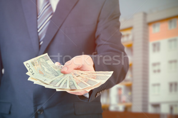 Polish businessman holds money. The loan on the house Stock photo © simpson33
