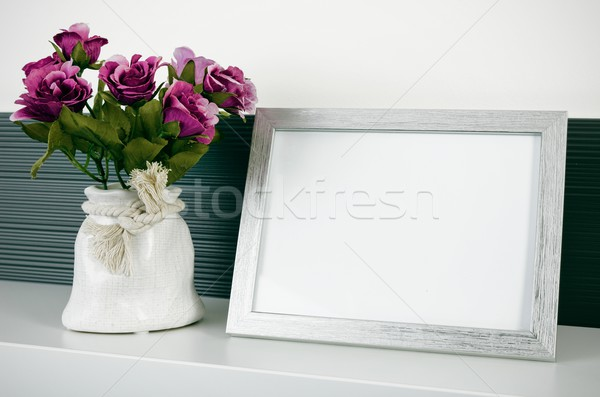 Photo frame stands on a shelf next to the flowers Stock photo © simpson33
