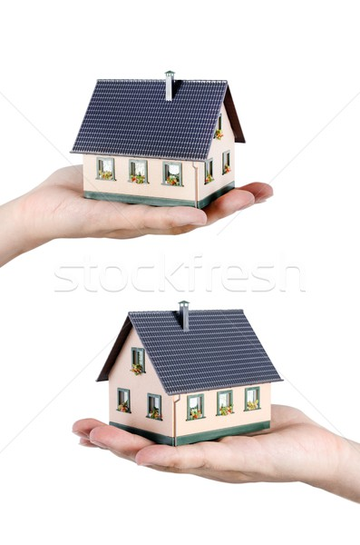 Hand holding house miniature. Home finance concept Stock photo © simpson33