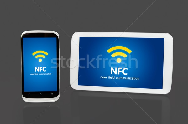 Mobile devices with NFC chip. Wireless communication and payment Stock photo © simpson33