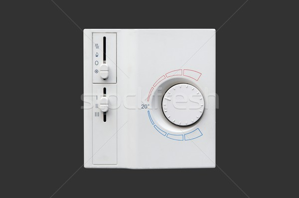 Air conditioner thermostat panel isolated on dark background Stock photo © simpson33