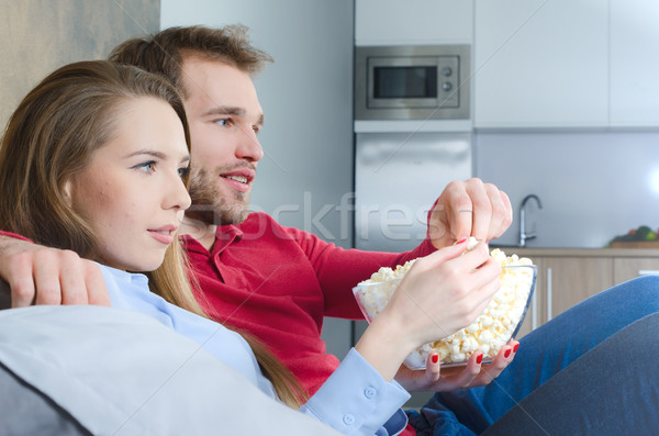 Couple temps libre regarder tv film maison Photo stock © simpson33