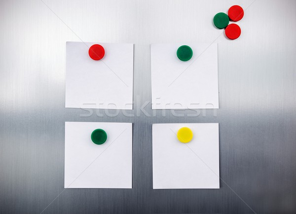 Stock photo: White reminders with magnets on fridge