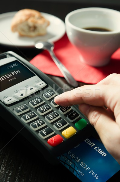Man making payment with terminal for sale in cafeteria Stock photo © simpson33
