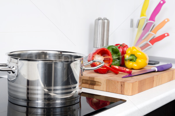 Pot and vegetables in modern kitchen with induction stove Stock photo © simpson33
