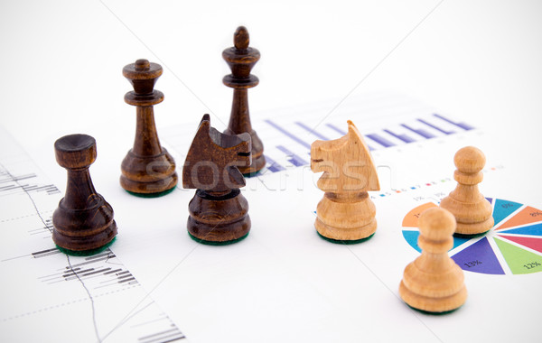 Chess pieces on business background. Company strategic behavior Stock photo © simpson33