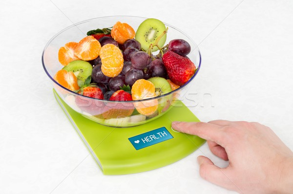 Lots of fruit on the kitchen scale in a modern kitchen Stock photo © simpson33