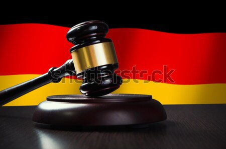 Wooden gavel with German flag in background Stock photo © simpson33