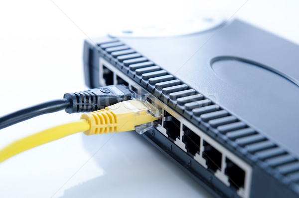 Network switch device and ethernet cables on white Stock photo © simpson33