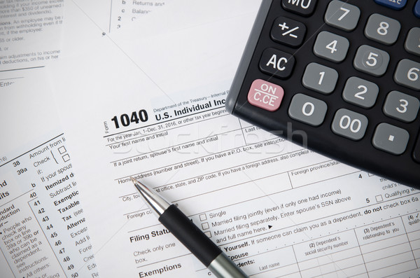 US tax form 1040 with pen and calculator Stock photo © simpson33