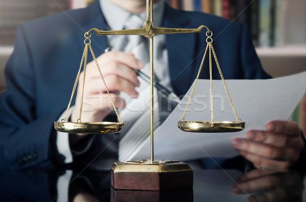 Weight scale of justice, lawyer in background Stock photo © simpson33