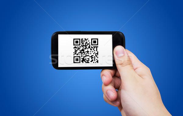 Smartphone scanning QR code Stock photo © simpson33