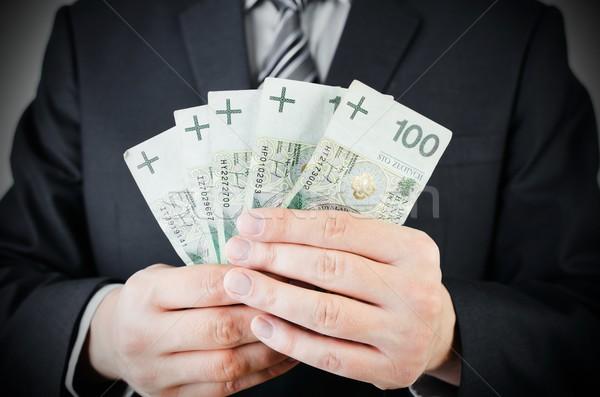 Alcance notas empresário mão dinheiro empréstimo Foto stock © simpson33