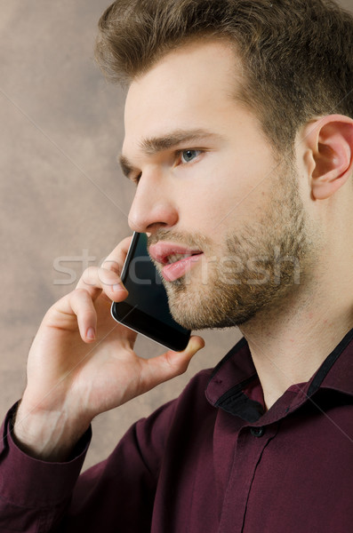 Yakışıklı adam konuşma telefon bo adam çağrı Stok fotoğraf © simpson33