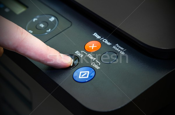 Man switching on start button of laser printer Stock photo © simpson33