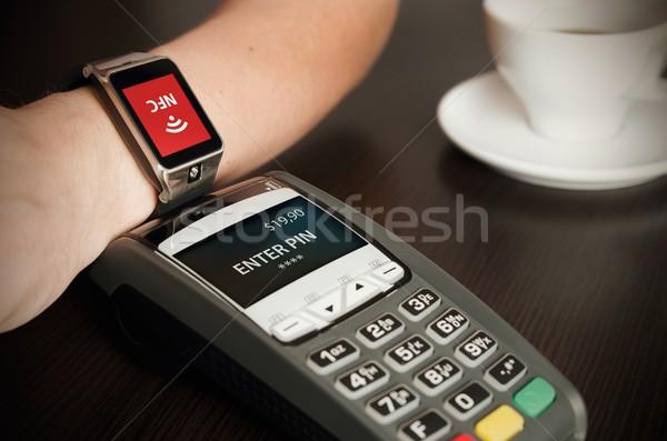 Man making payment through smartwatch via NFC technology Stock photo © simpson33