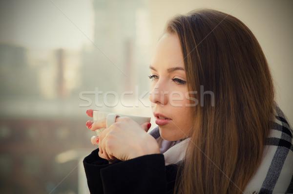 Nő iszik kávé teáscsésze erkély boldog Stock fotó © simpson33