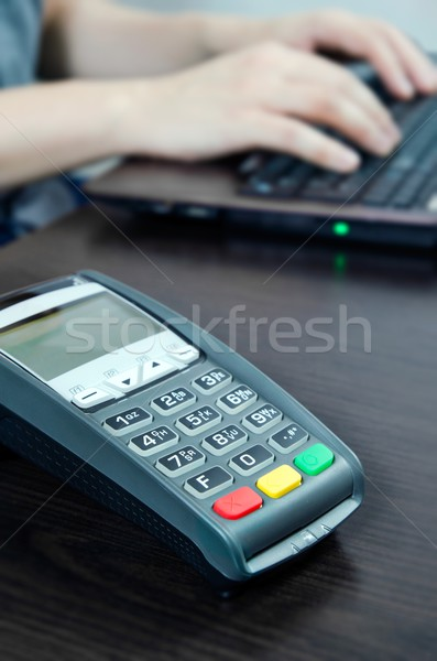 Payment terminal in the office. Man working with laptop in the b Stock photo © simpson33