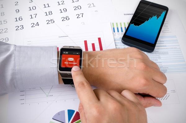 Férfi dolgozik okos óra iroda új Stock fotó © simpson33