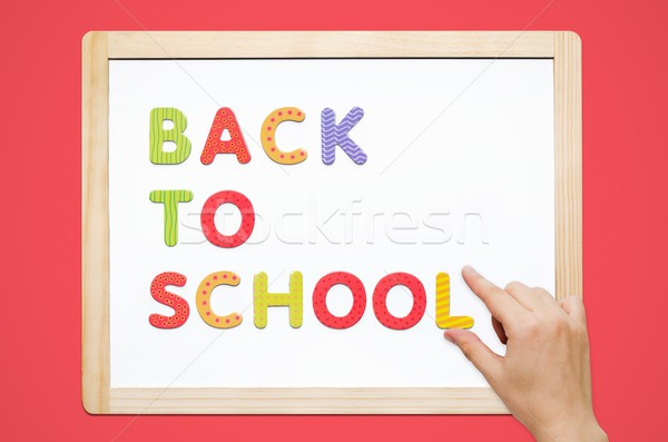 Hand put the words Back To School on magnetic board Stock photo © simpson33