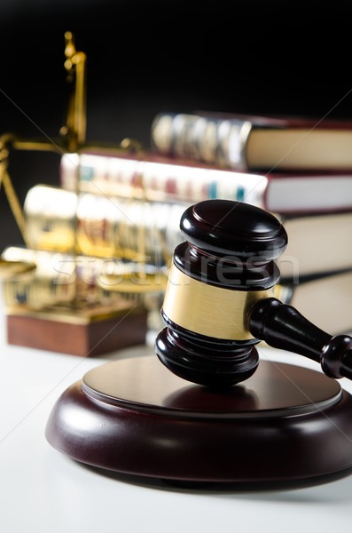 Judge gavel in court. Library with lot of books in background Stock photo © simpson33