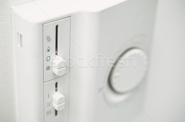 Air conditioner thermostat on wall. Close up photo Stock photo © simpson33