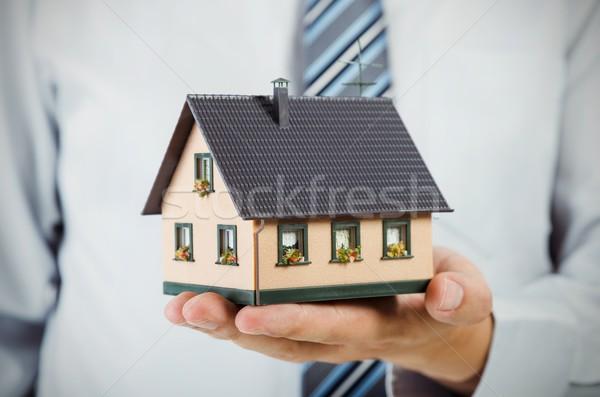 Realtor holding house miniature. Home finance concept Stock photo © simpson33