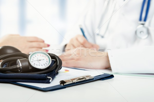 Doctor and patient medical consultation Stock photo © simpson33