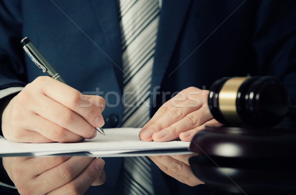 Stock photo: Lawyer working with agreement in office