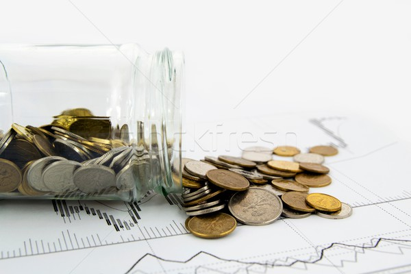 Coins Spilled From Jar on business background Stock photo © simpson33